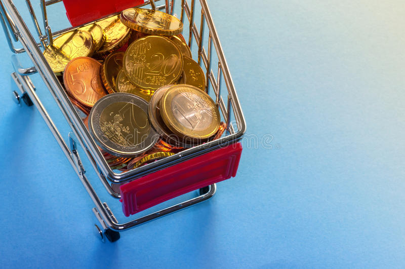 A shopping cart with euro coins. Symbolic photo for purchasing power and consumption stock photography