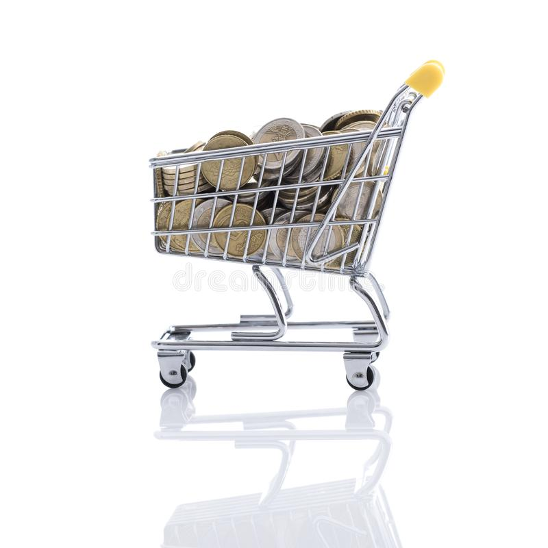 Shopping cart filled with currency. Supermarket shopping cart full of money on white background: retail, price and savings concept stock photo