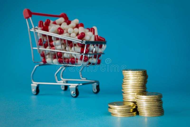 Shopping cart filled red medicinal capsules stock photo