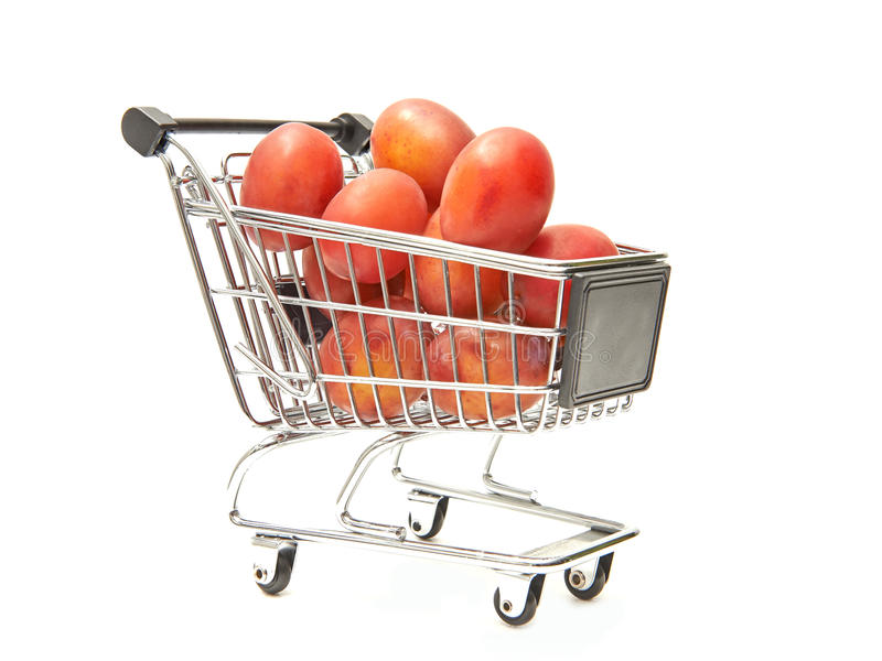 Shopping cart filled with red plums royalty free stock photos