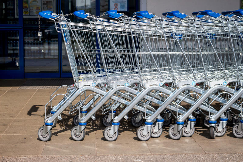 Shopping cart in front of a supermarket stock image