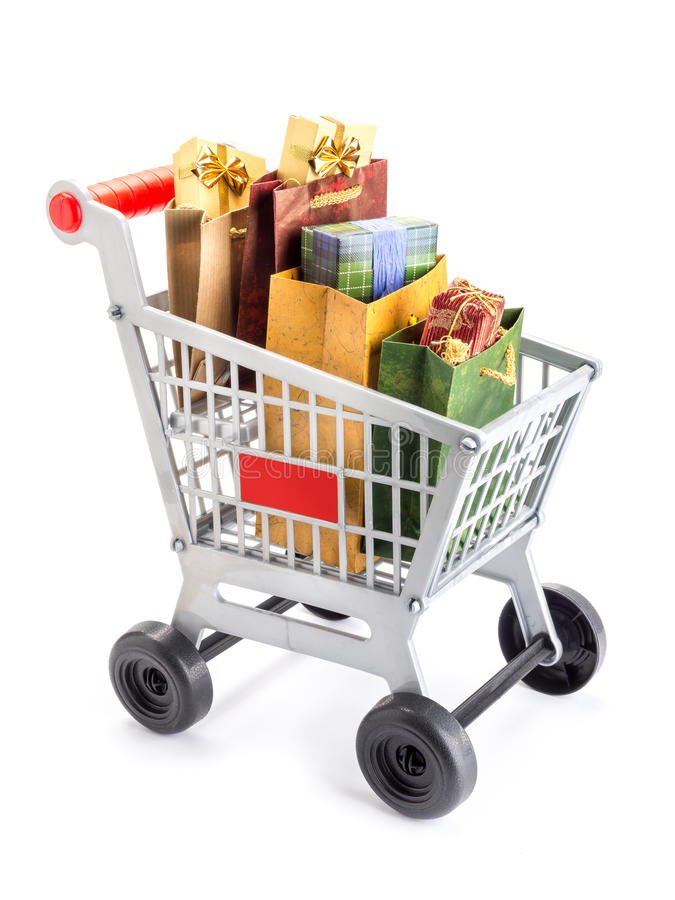 Shopping cart. Full of bags filled with presnts and gifts shot on white royalty free stock photo