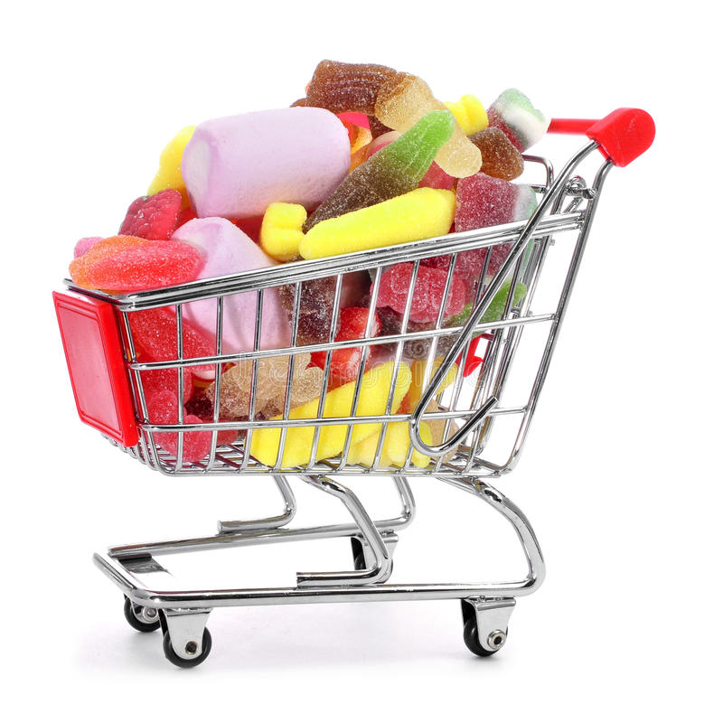 Shopping cart full of candies. On a white background stock images