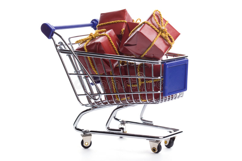 Shopping cart full with christmas present box. Isolated on white background royalty free stock photos