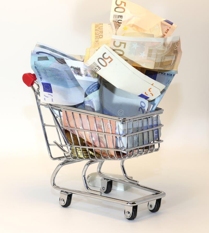 Shopping cart full of crumpled euro money. European shopping cart full of crumpled euro money royalty free stock photos