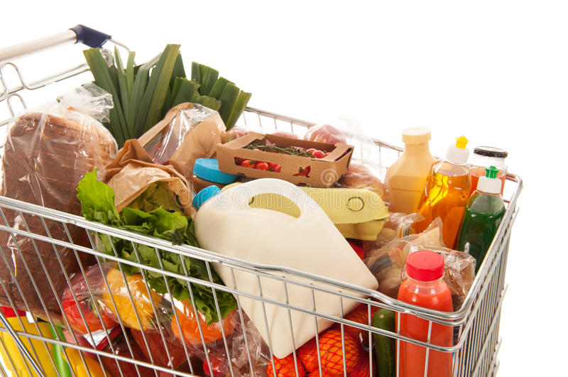 Shopping cart full dairy grocery royalty free stock photography