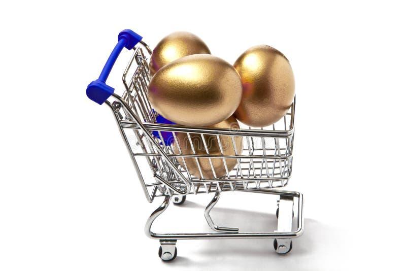 Shopping Cart Full of Easter Eggs. Shopping Cart Full of Easter golden Eggs royalty free stock photo