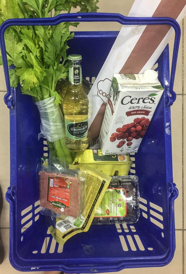 Shopping cart full of food in the supermarket. Saigon, Vietnam - Dec 25, 2017. Shopping cart full of food in the supermarket in Saigon Ho Chi Minh City, Vietnam stock images