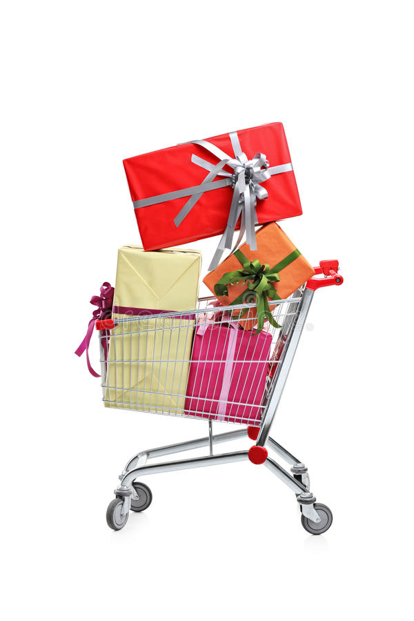 A shopping cart full with gifts. Isolated on white background stock photo