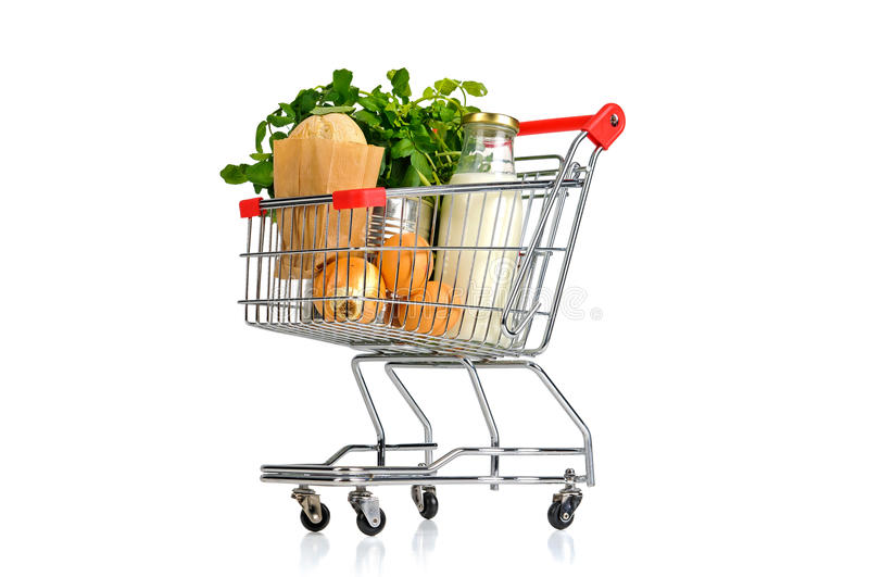 Shopping cart. Full with groceries isolated in white stock images