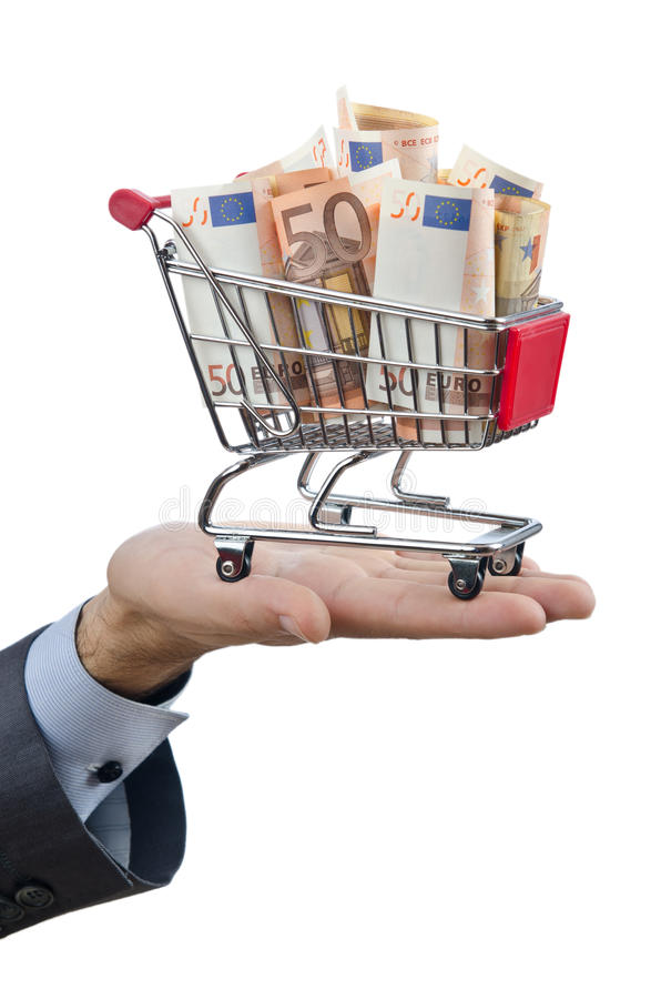 Shopping cart full of money. On white royalty free stock photography