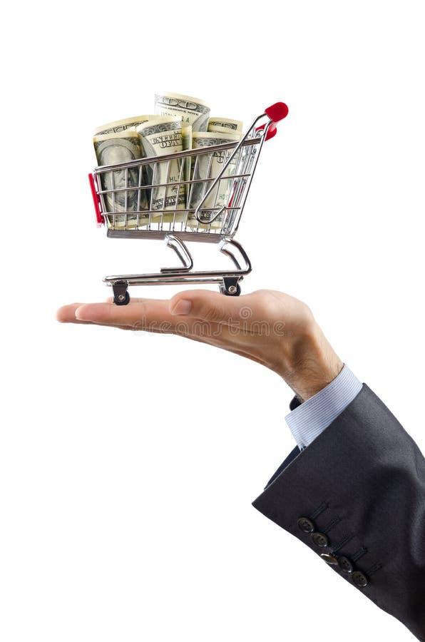 Shopping cart full of money. On the white background royalty free stock photos