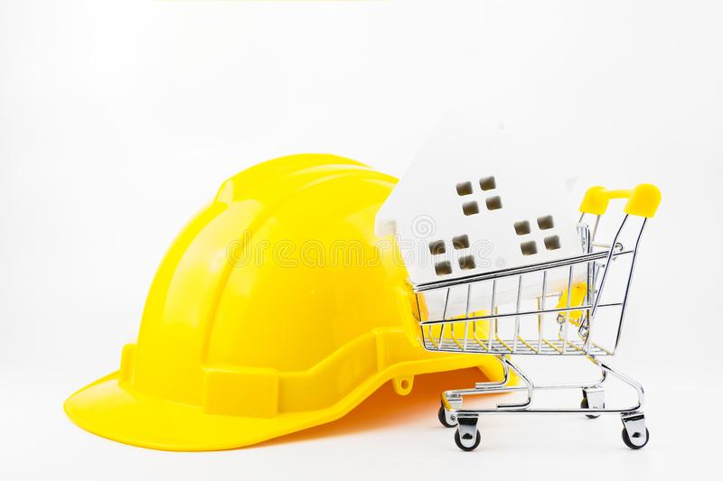 Shopping cart full of paper hose model and construction tools, i. Solated on white background with copy space.Real estate concept, New house concept, Repair royalty free stock images