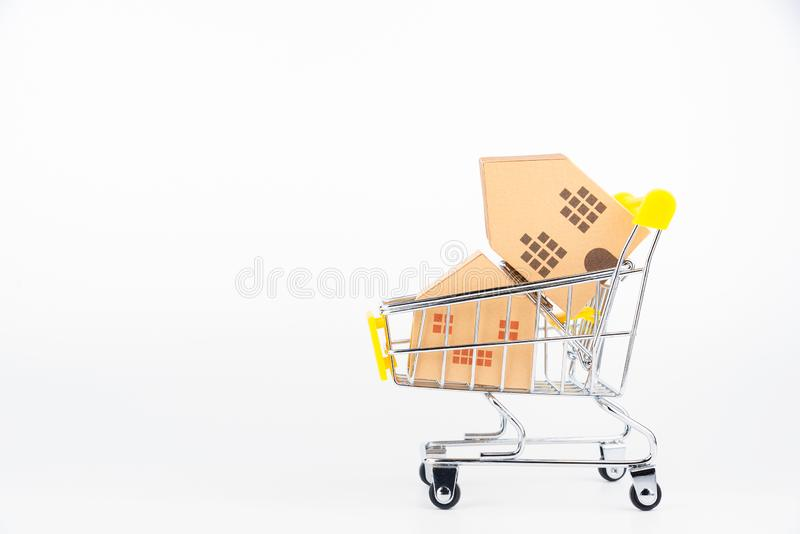 Shopping cart full of paper hose model, isolated on white background with copy space.Real estate concept, New house. Concept.Buying a house royalty free stock images