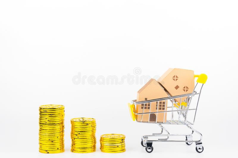 Shopping cart full of paper hose model, isolated on white background with copy space.Real estate concept, New house. Concept.Buying a house stock images