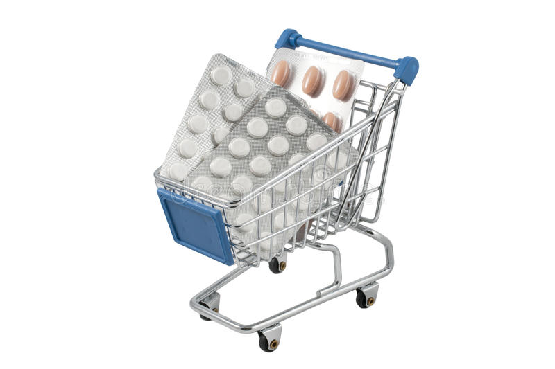 Shopping cart full of pills. (isolated on white royalty free stock photography