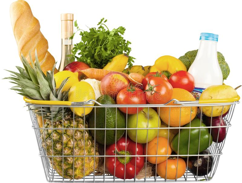 Shopping cart full with various groceries on stock image