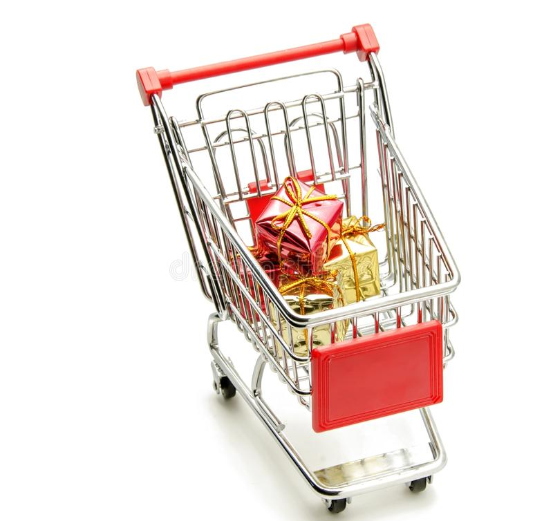 Shopping cart. With gift boxes in white background stock photo