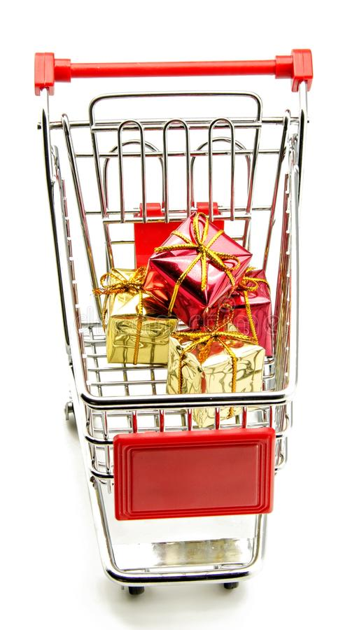 Shopping cart. With gift boxes in white background royalty free stock image