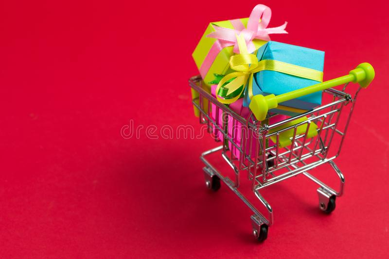 Shopping cart with gifts stock photo