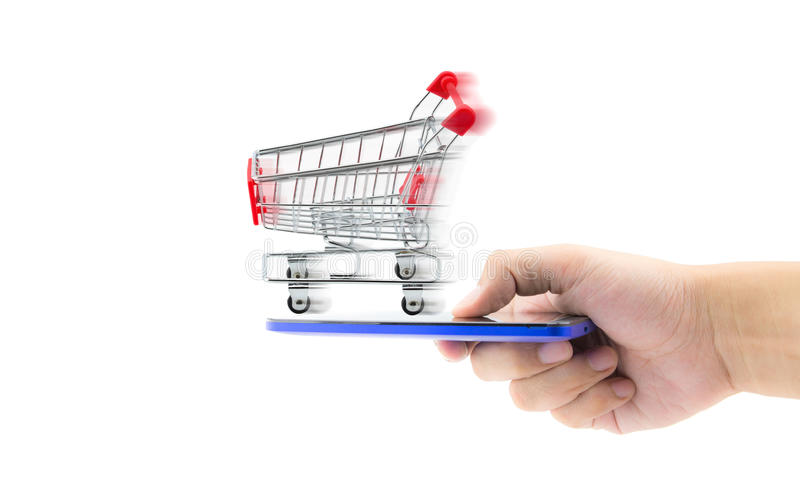 Shopping cart with hand holding mobile , business concept. Shopping online concept , business idea stock image