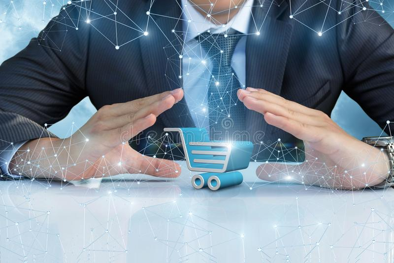 Shopping cart in the hands of the businessman. royalty free stock photo