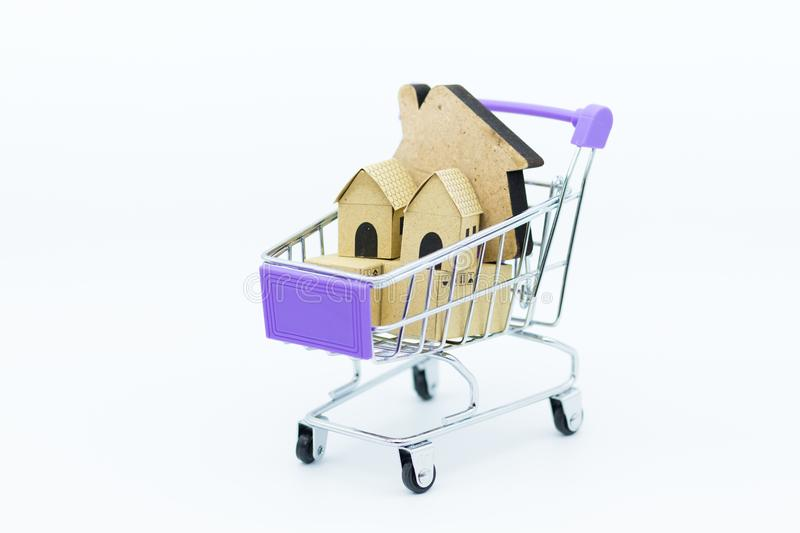 Shopping cart with home. Image use for Business consultants on financial transactions for home loan.  stock images