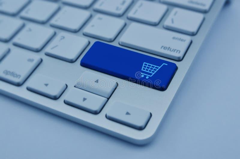 Shopping cart icon on modern computer keyboard button, Shopping royalty free stock photos