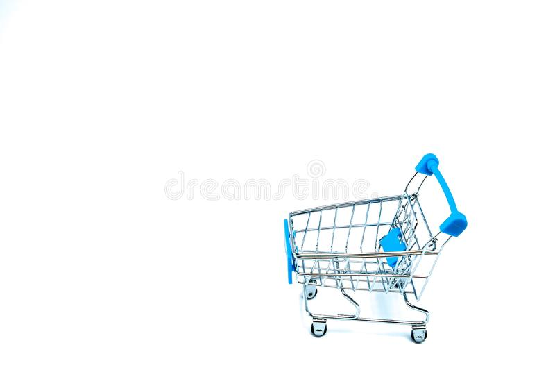 Shopping cart isolated on white background. Minimal concept. Space for text on the left side of frame royalty free stock photography