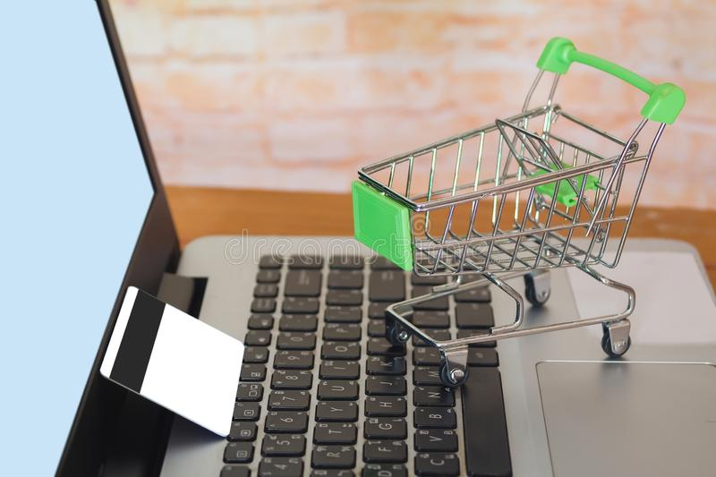 Shopping cart On Laptop Keyboard With Credit Card, Online Shopping. Concept stock photos
