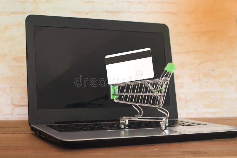 Shopping cart On Laptop Keyboard With Credit Card, Online Shopping. Concept royalty free stock images