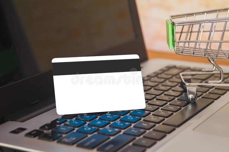 Shopping cart On Laptop Keyboard With Credit Card, Online Shopping. Concept royalty free stock image