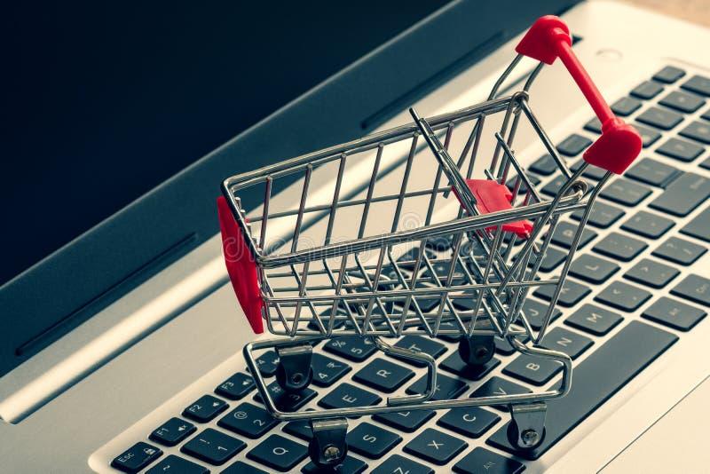 Shopping cart on laptop keyboard stock image