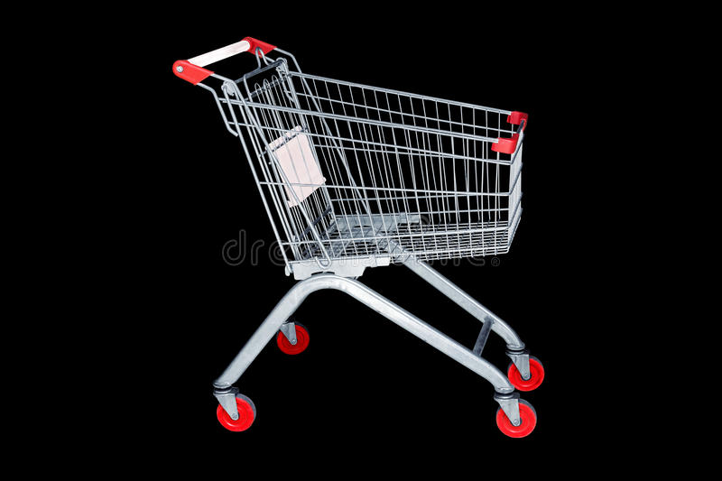 Shopping cart in marketing shop isolated on black background stock image