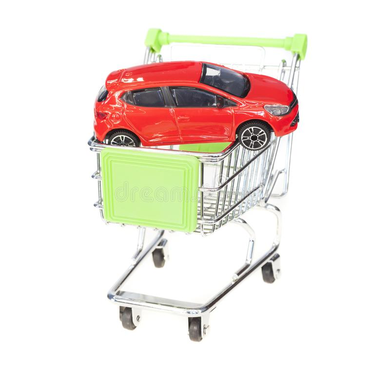 Shopping cart and new toy car, stock image