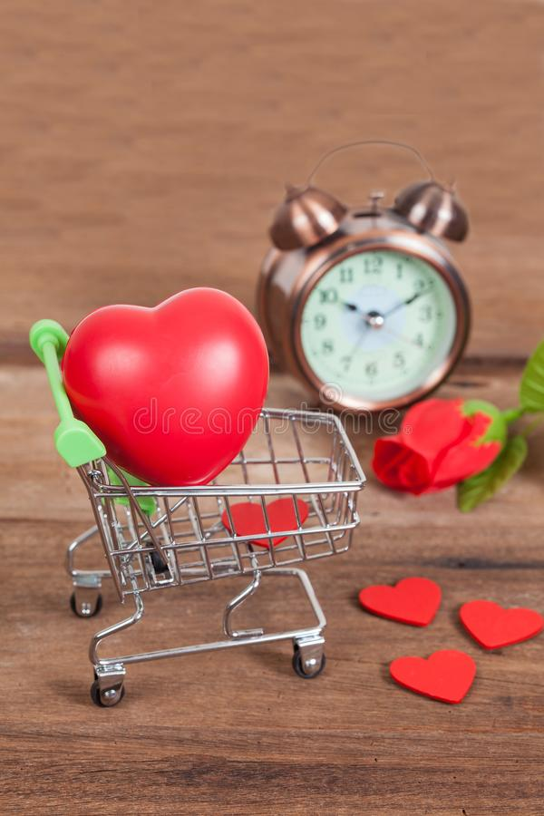 Shopping cart and old clock ,time to shopping. Online stock photos