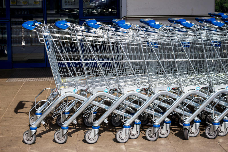 Shopping cart outside a supermarket stock photography