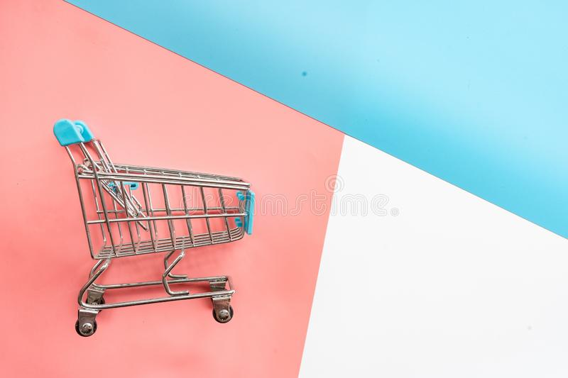 shopping cart on pastel background royalty free stock images