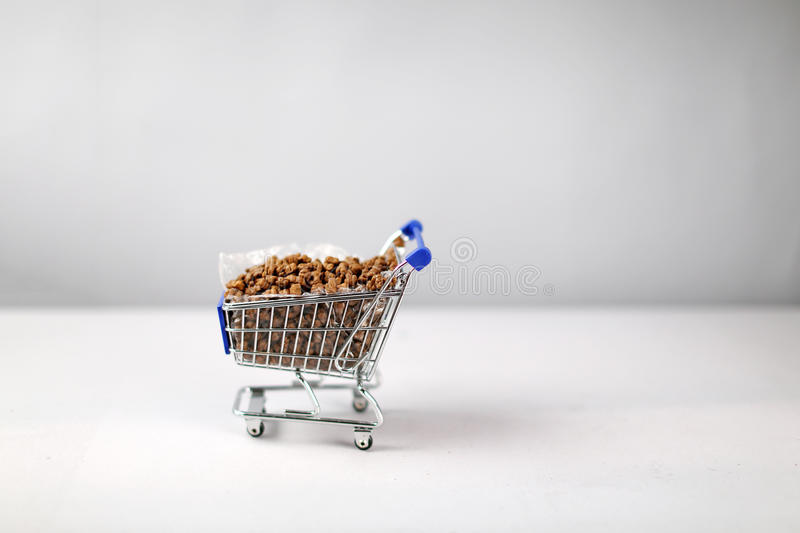 Shopping cart with pet food. Shopping cart full of pet food, cat food royalty free stock images