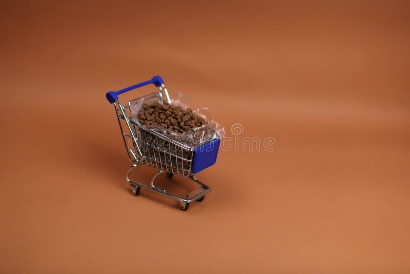 Shopping cart with pet food. Shopping cart full of pet food, cat food stock photos