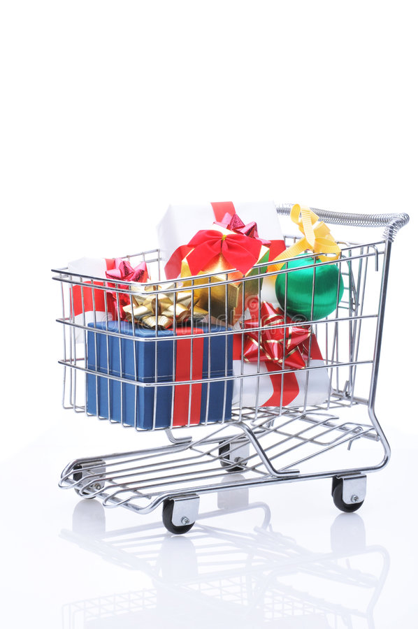 Shopping Cart with Presents. Shopping Cart Full of Christmas Presents isolated over white royalty free stock image