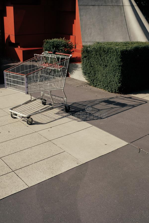 A shopping cart in a random urban area royalty free stock image