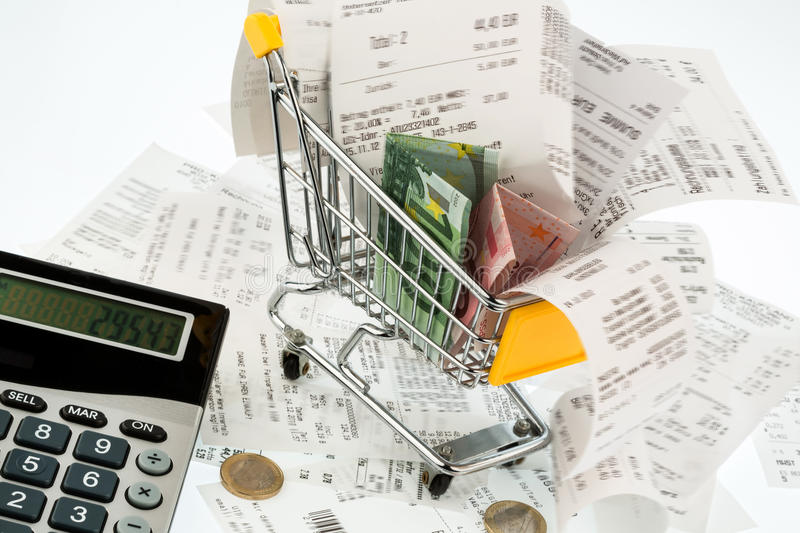 Shopping cart, receipts and money stock photo