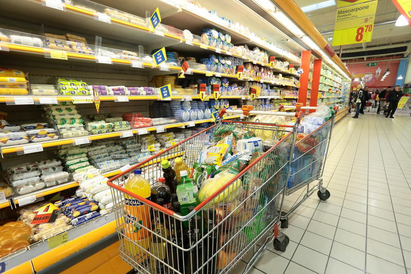 Shopping cart between the shelves stock images