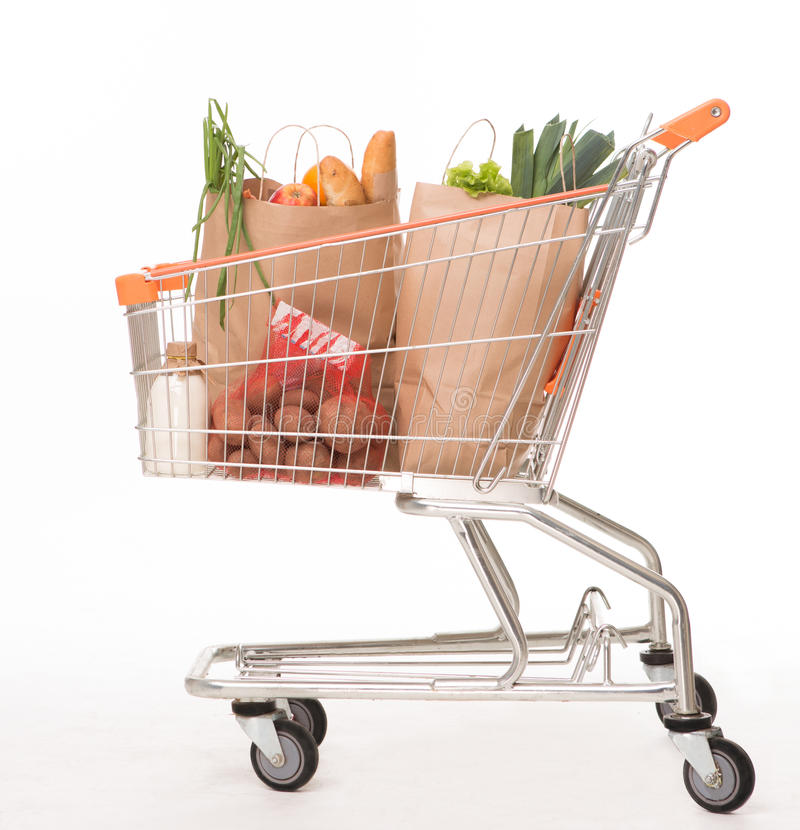 Shopping cart with shopping bags royalty free stock photography