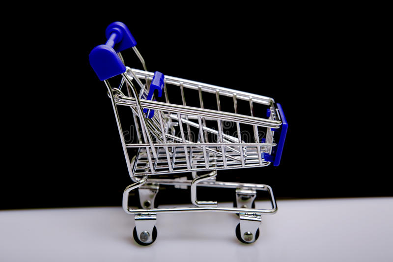 Shopping cart. Small shopping cart, studio picture stock photo