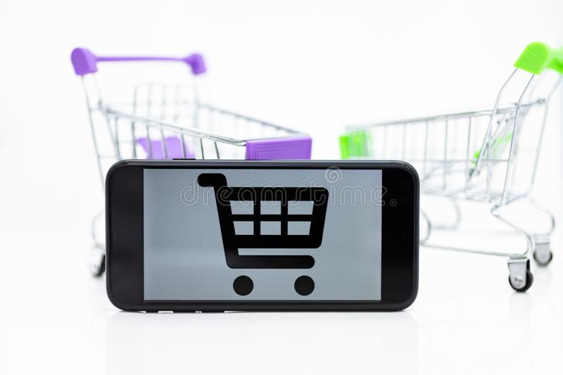 Shopping Cart and smart phone , image use for retail business online for support of customer on internet, marketing business. Concept royalty free stock photography