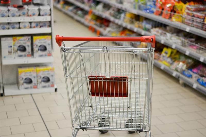 The shopping cart is still empty, and it takes a lot of money to fill it. Buying and selecting in the supermarkets of shopping malls, is now a habit of millions stock photo