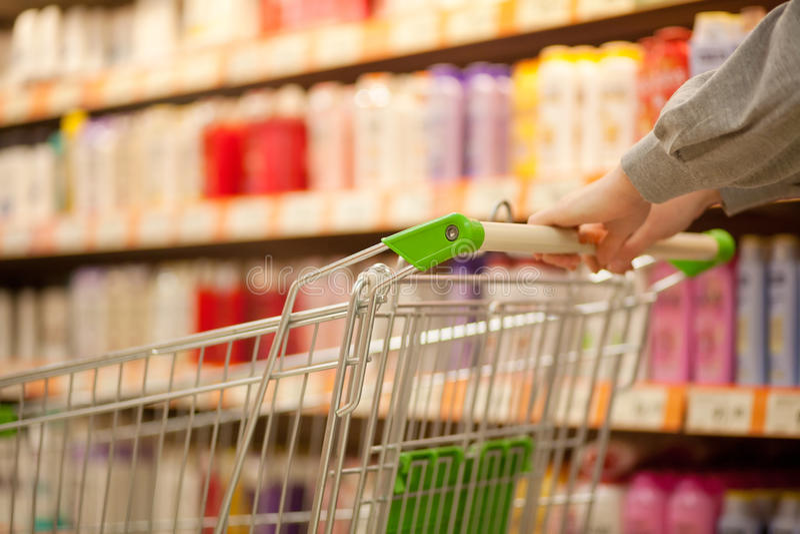 Shopping cart in supermarket stock photos
