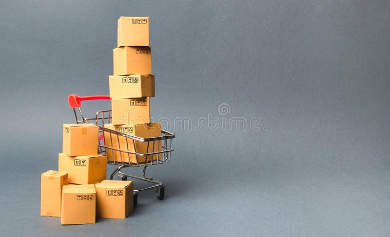 Shopping cart supermarket with boxes. Sales of products. The concept commerce, online shopping. E-commerce, sales and sale stock images